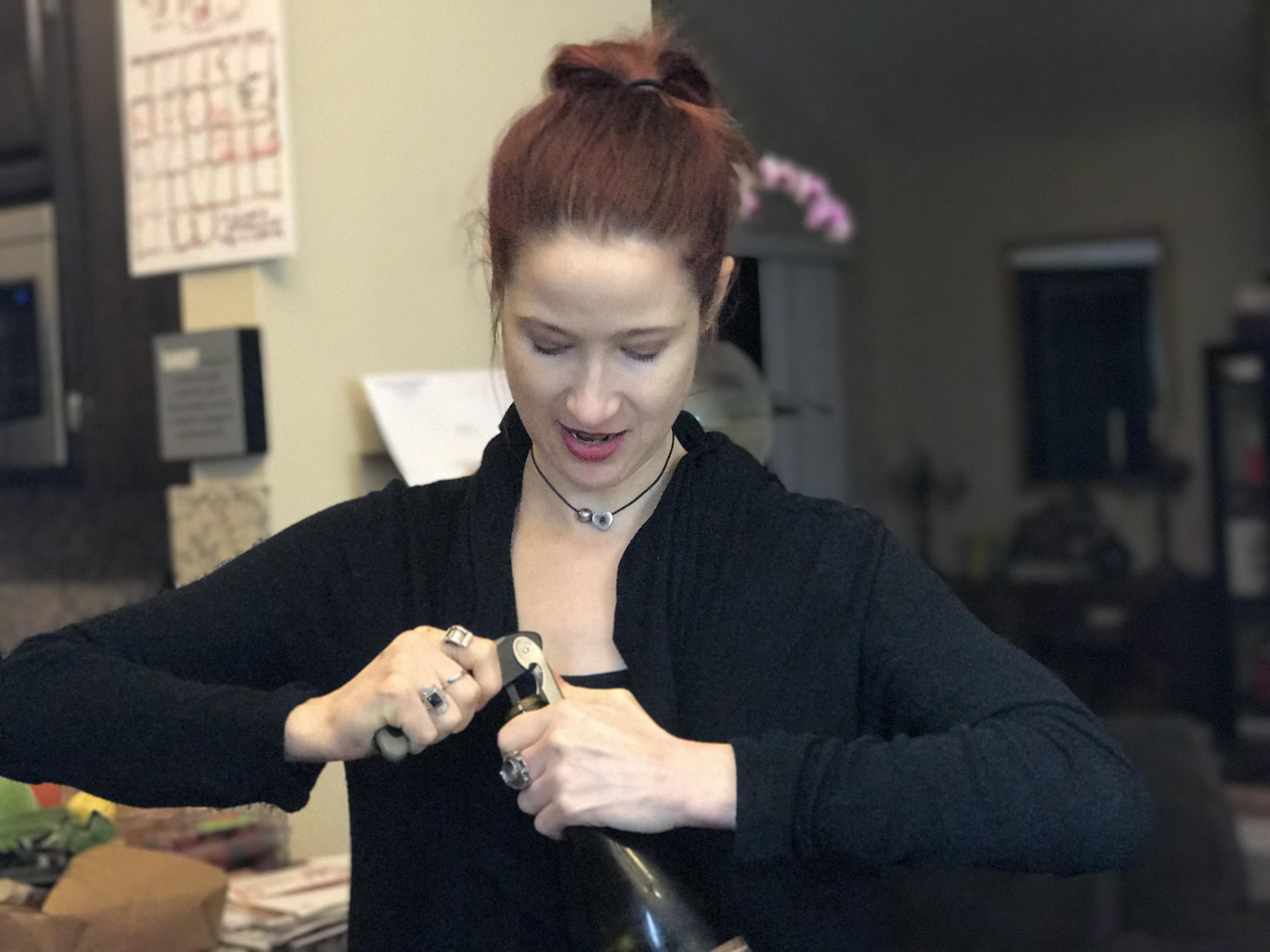 Ellen opening wine